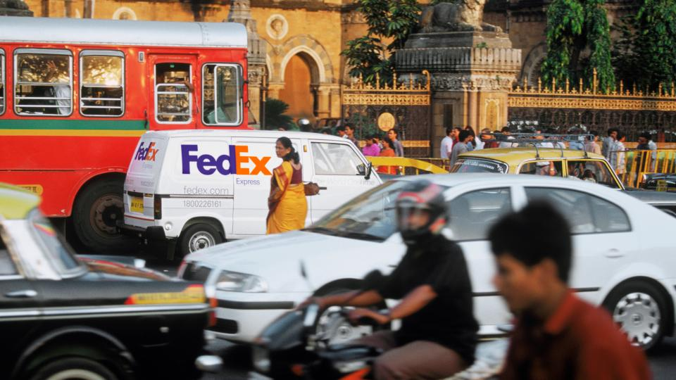 FedEx truck in traffic in India