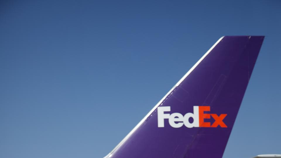 FedEx pallets in front of a FedEx plane